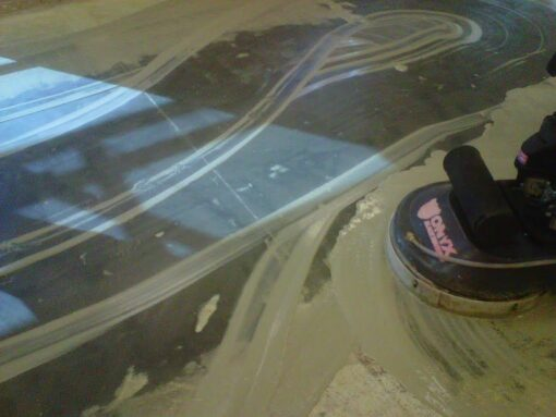 removing carpet glue with propane burnisher
