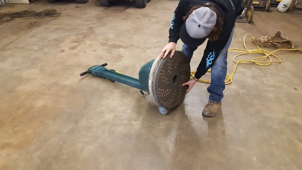 Remove scratches from concrete floor